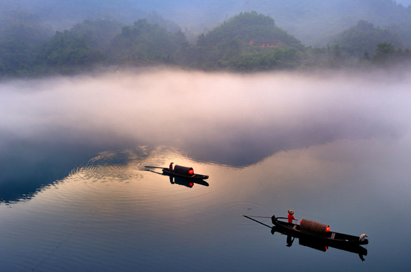 two boats on a misty morning